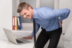 man feeling pain in back
